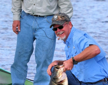 Tom Champeau with Johnny Morris and his 11 pound bass!